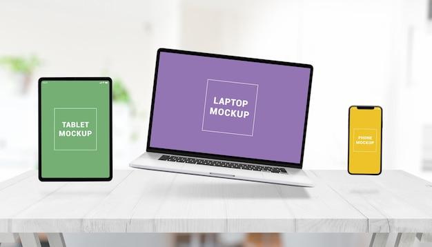 Maquete responsiva com laptop, tablet e telefone levitando