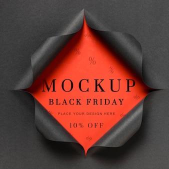 Maquete vermelha e papel rasgado preto sexta-feira