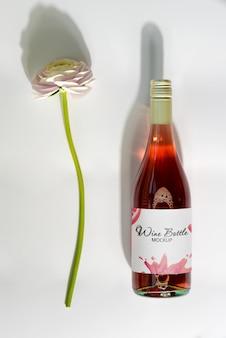 Maquete vinho rosado com flor