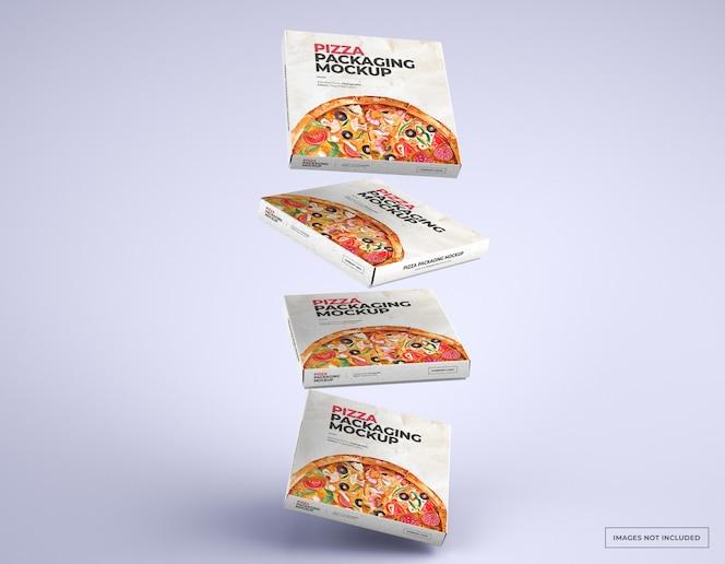 Maquetes de caixas de pizza caindo com design editável