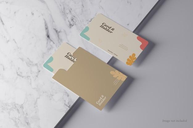 Maquetes de cartão e suporte em uma vista de pedra de mármore