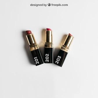 Maquiagem cosmética com três batons