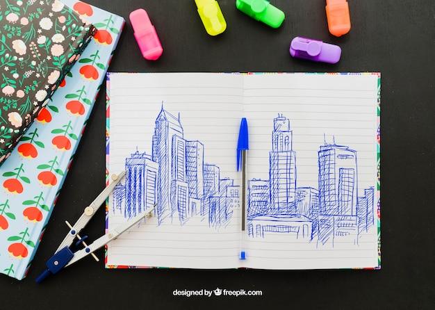 Marcadores, pastas, bússola e desenho de caneta