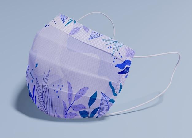 Máscara roxa com folhas padrão