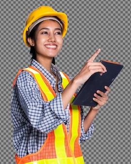 Meio corpo 20 anos, arquiteto asiático, mulheres, com capacete amarelo, amplo refletor de segurança, isolado. trabalhador de pele bronzeada usa tablet digital para verificar o projeto da construção, plano de fundo branco do estúdio