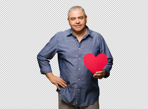 Meio envelhecido homem comemorando o dia dos namorados com as mãos nos quadris