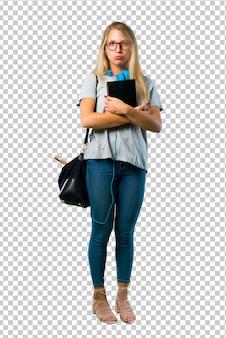 Menina do estudante com vidros com expressão triste e deprimida. gesto sério