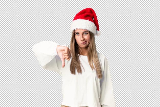 Menina loira com chapéu de natal, mostrando o polegar para baixo sinal