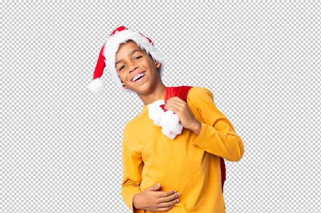 Menino afro-americano com chapéu de natal