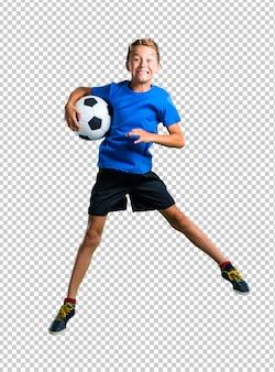 Menino, futebol jogando, e, pular
