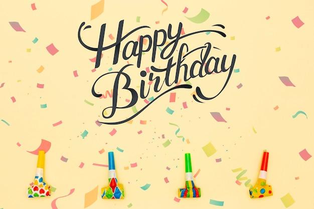 Mensagem de feliz aniversário ao lado de decorações