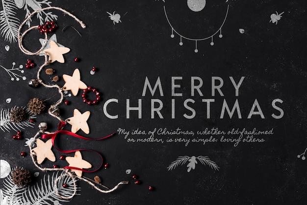Mensagem de natal ao lado de maquete de decorações