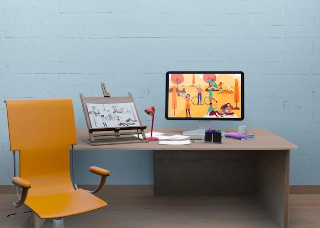 Mesa com maquete e desenho artístico