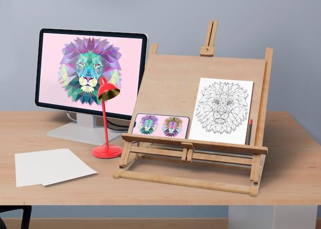Mesa com suporte de pintura e monitor