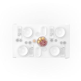 Mesa com toalha de mesa e louça
