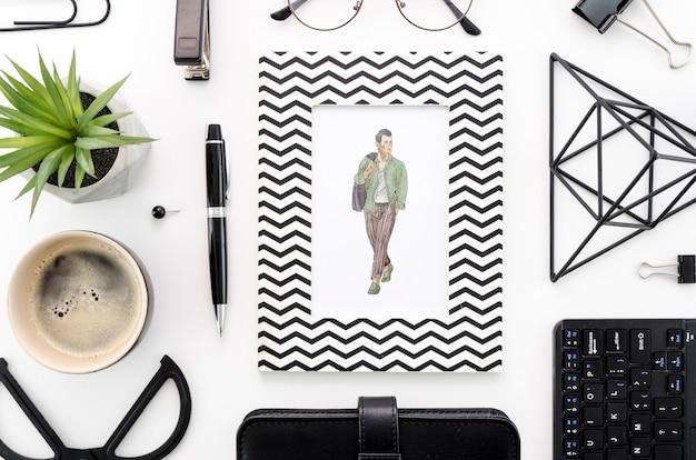 Mesa de escritório com maquete de café e retângulo