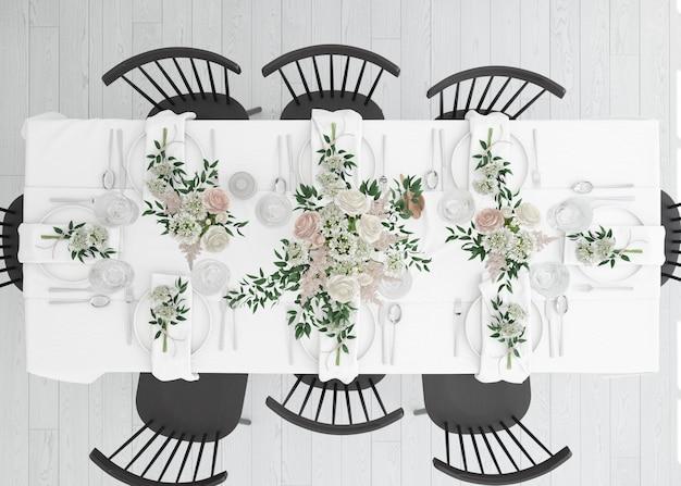 Mesa preparada para comer com talheres e flores decorativas na vista superior