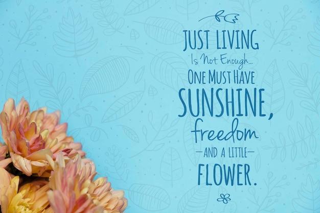 Mock-up mensagem motivacional ao lado de flores