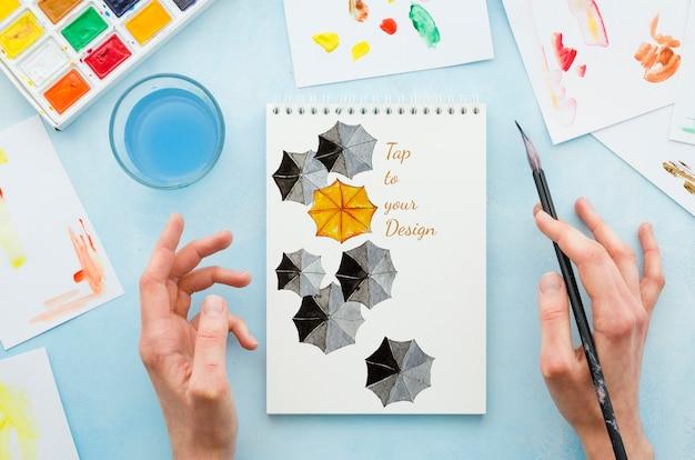 Mock-up notebook com desenho realista