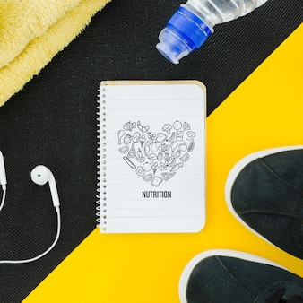 Mock-up notebook e equipamento desportivo