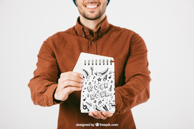 Mock up of young man with notebook