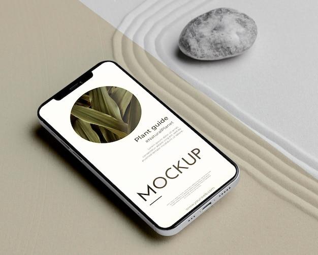 Mock-up smartphone em arranjo de areia