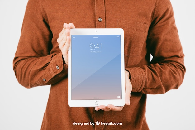 Mock up with young man holding tablet