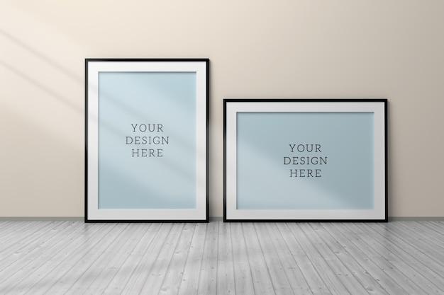 Mockup psd editável com dois quadros em branco a4 preto a4 horizontal e vertical de pé no chão