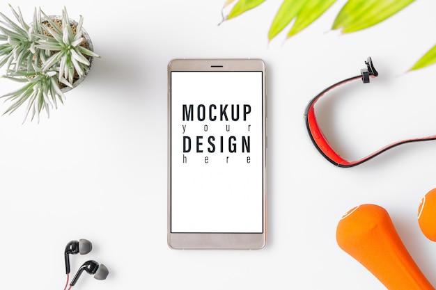 Mockup telefone móvel para o conceito saudável de aptidão.