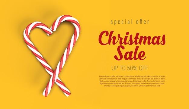 Modelo de banner de venda de natal com coração de bastão de doces amarelo