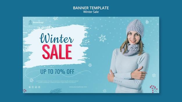 Modelo de banner horizontal para venda de inverno com mulher e flocos de neve
