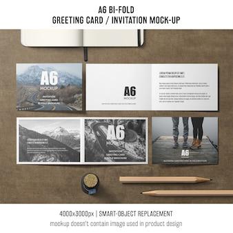 Modelo de cartão de convite bi-fold criativo a6