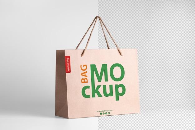 Modelo de embalagem de maquete de sacola de compras de papel com logotipo em vista em perspectiva