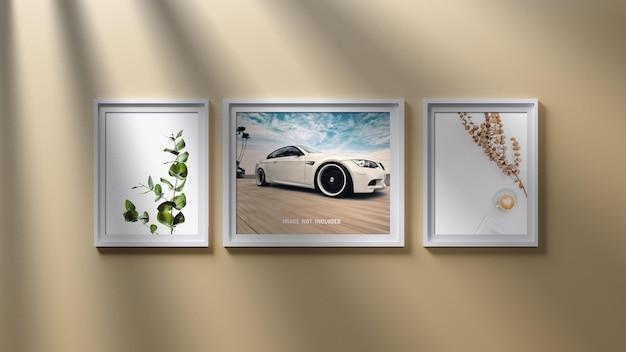 Modelo de moldura de três fotos na parede