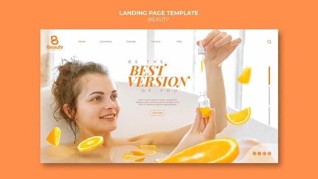 Modelo de página de destino para cuidados com a pele de spa em casa com fatias de mulher e laranja