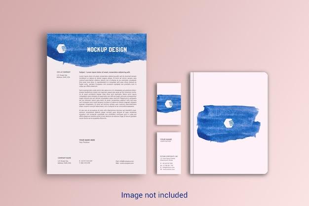 Modelo de papel timbrado, cartão de visita e notebook