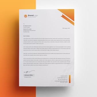 Modelo de papel timbrado da empresa com acento laranja