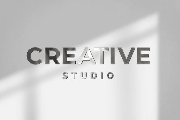 Modelo de psd de logotipo de negócios de estúdio criativo em textura de aço