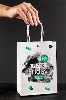 Modelo de saco preto sexta-feira conceito