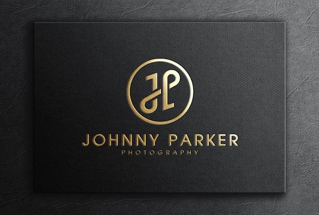 Modelos de logotipo de folha de ouro de luxo em cartão preto texturizado