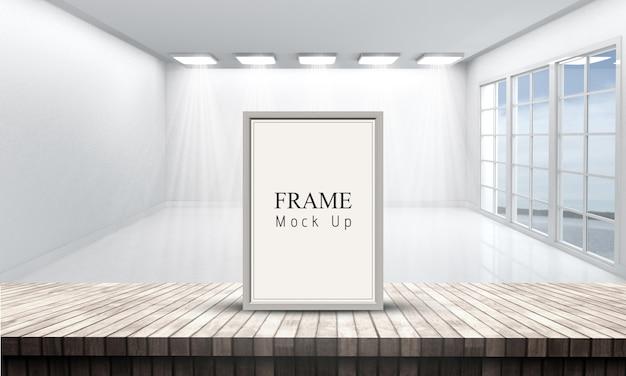 Moldura 3d em uma mesa de madeira com vista para uma sala vazia branca