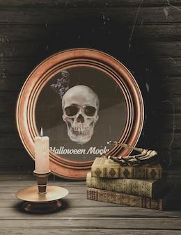 Moldura redonda de halloween com caveira e pilha de livros