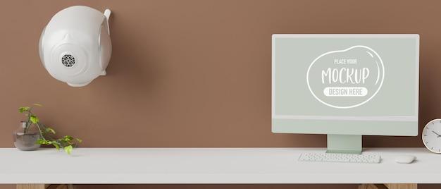 Monitor de computador com tela de maquete na mesa branca com decoração e renderização 3d de alto-falante