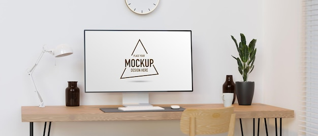 Monitor de computador com tela de maquete na mesa de madeira com decorações em um quarto mínimo