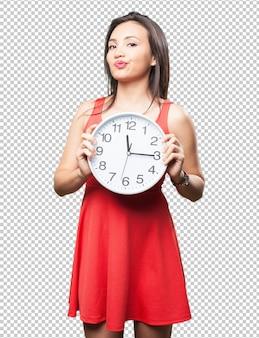 Mulher asian, segurando, um, relógio
