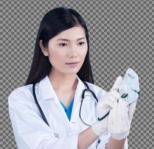 Mulher asiática bonita do médico enfermeira de uniforme com estetoscópio, luvas de borracha, máscara de oxigênio no hospital médico, retrato, maquiagem, cabelo preto liso, iluminação de estúdio, espaço de cópia de fundo azul