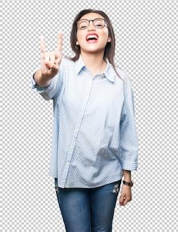 Mulher asiática, fazendo, gesto rocha