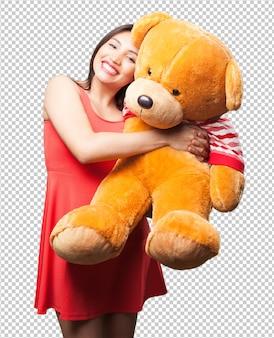 Mulher asiática, segurando um urso de pelúcia