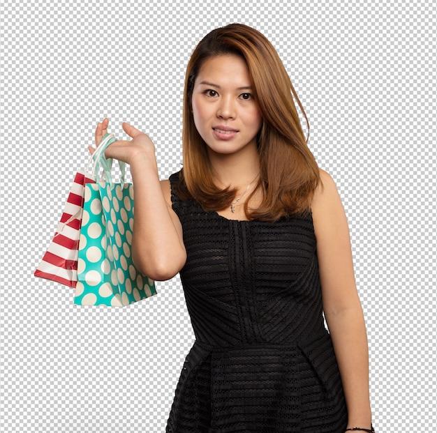 Mulher chinesa, segurando, bolsas para compras