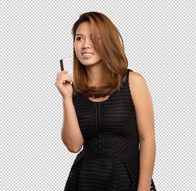 Mulher chinesa segurando um cartão de crédito